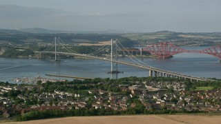 AX111_099 - 6K stock footage aerial video of the Forth Road Bridge in Edinburgh, Scotland
