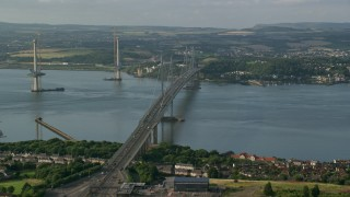 AX111_102 - 6K stock footage aerial video of Forth Road Bridge and Firth of Forth, Edinburgh, Scotland