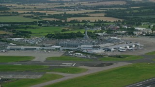 AX111_105 - 6K stock footage aerial video of Edinburgh Airport and farmland, Scotland