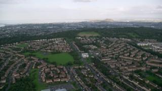 AX111_110 - 6K stock footage aerial video fly over suburban residential areas, Edinburgh, Scotland