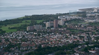 AX111_111 - 6K stock footage aerial video of apartment buildings near the water, Edinburgh, Scotland