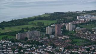 AX111_112 - 6K stock footage aerial video of apartment buildings near the water, Edinburgh, Scotland