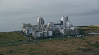 AX111_116 - 6K stock footage aerial video of apartment buildings by the water, Edinburgh, Scotland