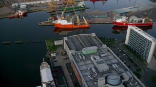 AX111_119 - 6K stock footage aerial video approach ships at the Port of Edinburgh, Scotland
