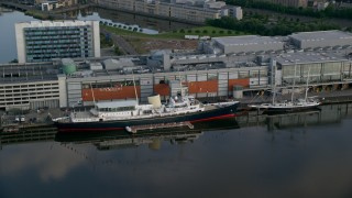 AX111_121 - 6K stock footage aerial video of the HMY Britannia at Port of Edinburgh, Scotland