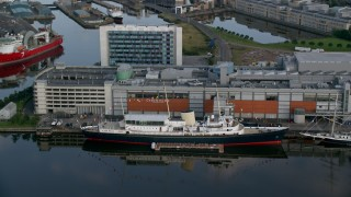 AX111_122 - 6K stock footage aerial video of HMY Britannia at the Port of Edinburgh, Scotland