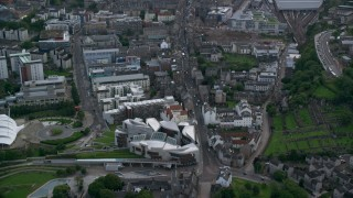 AX111_130 - 6K stock footage aerial video of Scottish Parliament and Canongate, Edinburgh, Scotland