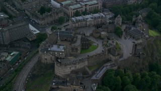 AX111_136 - 6K stock footage aerial video fly over Edinburgh Castle and tilt to courtyard, Scotland