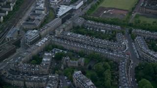 AX111_138 - 6K stock footage aerial video approach row houses in Edinburgh, Scotland