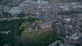 AX111_139 - 6K stock footage aerial video approach Edinburgh Castle in Scotland
