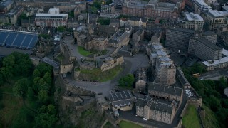 AX111_142 - 6K stock footage aerial video of orbiting historic Edinburgh Castle, Edinburgh