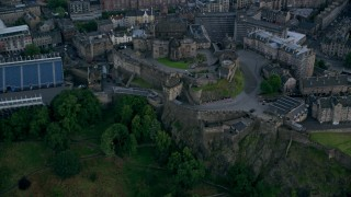 AX111_143 - 6K stock footage aerial video of passing historic Edinburgh Castle, Scotland
