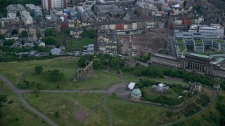 AX111_144 - 6K stock footage aerial video of monuments and observatory on Calton Hill, Edinburgh, Scotland