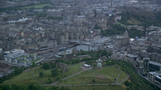 AX111_147 - 6K stock footage aerial video of Calton Hill and National Monument, tilt to view cityscape, Edinburgh, Scotland