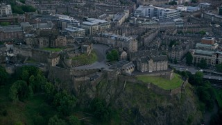 AX111_151 - 6K stock footage aerial video of orbiting historic Edinburgh Castle on a hilltop, Scotland