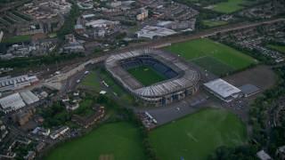 AX111_153 - 6K stock footage aerial video of orbiting Murrayfield Stadium, Edinburgh, Scotland