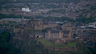 AX111_156 - 6K stock footage aerial video of Edinburgh Castle with a view of the cityscape, Scotland