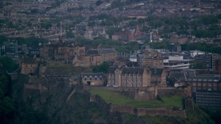 AX111_157 - 6K stock footage aerial video of flying by Edinburgh Castle and cityscape, Scotland