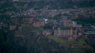 AX111_158 - 6K stock footage aerial video of passing by Edinburgh Castle and the cityscape, Scotland