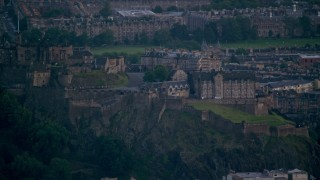 AX111_160 - 6K stock footage aerial video of a view of the historic Edinburgh Castle, Scotland