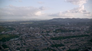 AX111_161 - 6K stock footage aerial video of the Edinburgh cityscape, Scotland