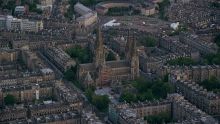 AX111_164 - 6K stock footage aerial video of orbiting St Mary's Cathedral, Edinburgh, Scotland