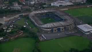 AX111_165 - 6K stock footage aerial video of orbiting Murrayfield Stadium, a rugby stadium in Edinburgh, Scotland