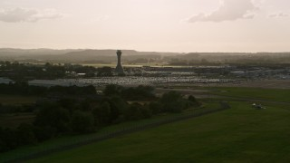 AX111_169 - 6K stock footage aerial video of Edinburgh Airport and control tower, Scotland
