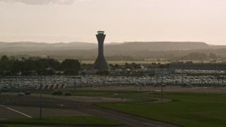 AX111_170 - 6K stock footage aerial video of the control tower at Edinburgh Airport, Scotland