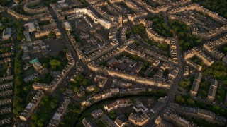 AX112_011 - 6K stock footage aerial video of flying over row houses, Edinburgh, Scotland at sunset