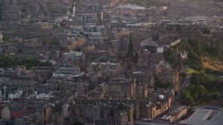 AX112_017 - 6K stock footage aerial video of The Hub near Edinburgh Caste in Scotland at sunset