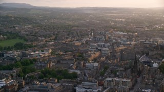 AX112_022 - 6K stock footage aerial video of the cityscape of Edinburgh, Scotland at sunset