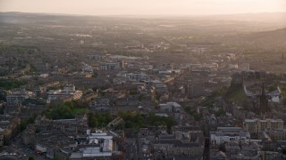 AX112_023 - 6K stock footage aerial video of a view of the cityscape of Edinburgh, Scotland at sunset
