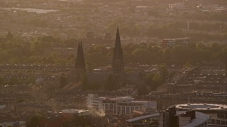 AX112_029 - 6K stock footage aerial video of flying by St Mary's Cathedral, Edinburgh, Scotland at sunset