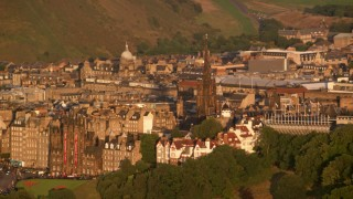 AX112_033 - 6K stock footage aerial video of The Hub cathedral, Edinburgh, Scotland at sunset