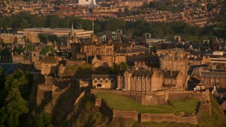 AX112_034 - 6K stock footage aerial video of passing Edinburgh Castle, Scotland at sunset