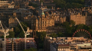 AX112_039 - 6K stock footage aerial video of Lloyds Bank Headquarters office building in Edinburgh, Scotland at sunset