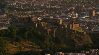 AX112_041 - 6K stock footage aerial video of a view of Edinburgh Castle in Scotland at sunset