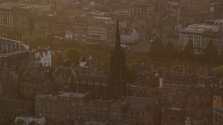 AX112_047 - 6K stock footage aerial video of The Hub cathedral in Edinburgh, Scotland at sunset