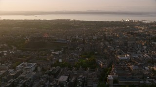 AX112_048 - 6K stock footage aerial video of Edinburgh Castle and surrounding cityscape at sunset in Scotland