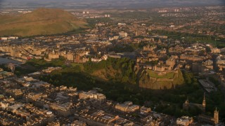 AX112_055 - 6K stock footage aerial video of orbiting Edinburgh Castle and Cityscape, Scotland at sunset