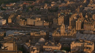 AX112_057 - 6K stock footage aerial video of Balmoral Hotel, Edinburgh, Scotland at sunset
