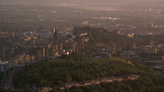 AX112_062 - 6K stock footage aerial video of Edinburgh Castle and Calton Hill, Scotland at sunset