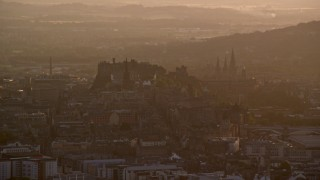 AX112_065 - 6K stock footage aerial video flyby historic Edinburgh Castle and cityscape, Scotland at sunset