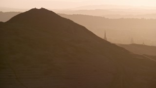 AX112_069 - 6K stock footage aerial video of Arthur's Seat in Edinburgh Scotland at sunset
