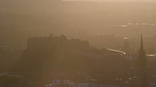 AX112_072 - 6K stock footage aerial video approach iconic Edinburgh Castle, Scotland at sunset