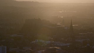 AX112_073 - 6K stock footage aerial video of historic Edinburgh Castle and The Hub cathedral, Scotland at sunset