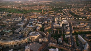 AX112_082 - 6K stock footage aerial video of panning across office buildings, Edinburgh, Scotland at sunset
