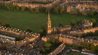 AX112_083 - 6K stock footage aerial video of Barclay Viewforth Church, Edinburgh, Scotland at sunset