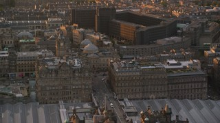 AX112_086 - 6K stock footage aerial video of the Balmoral Hotel and National Archives, Edinburgh Scotland Sunset